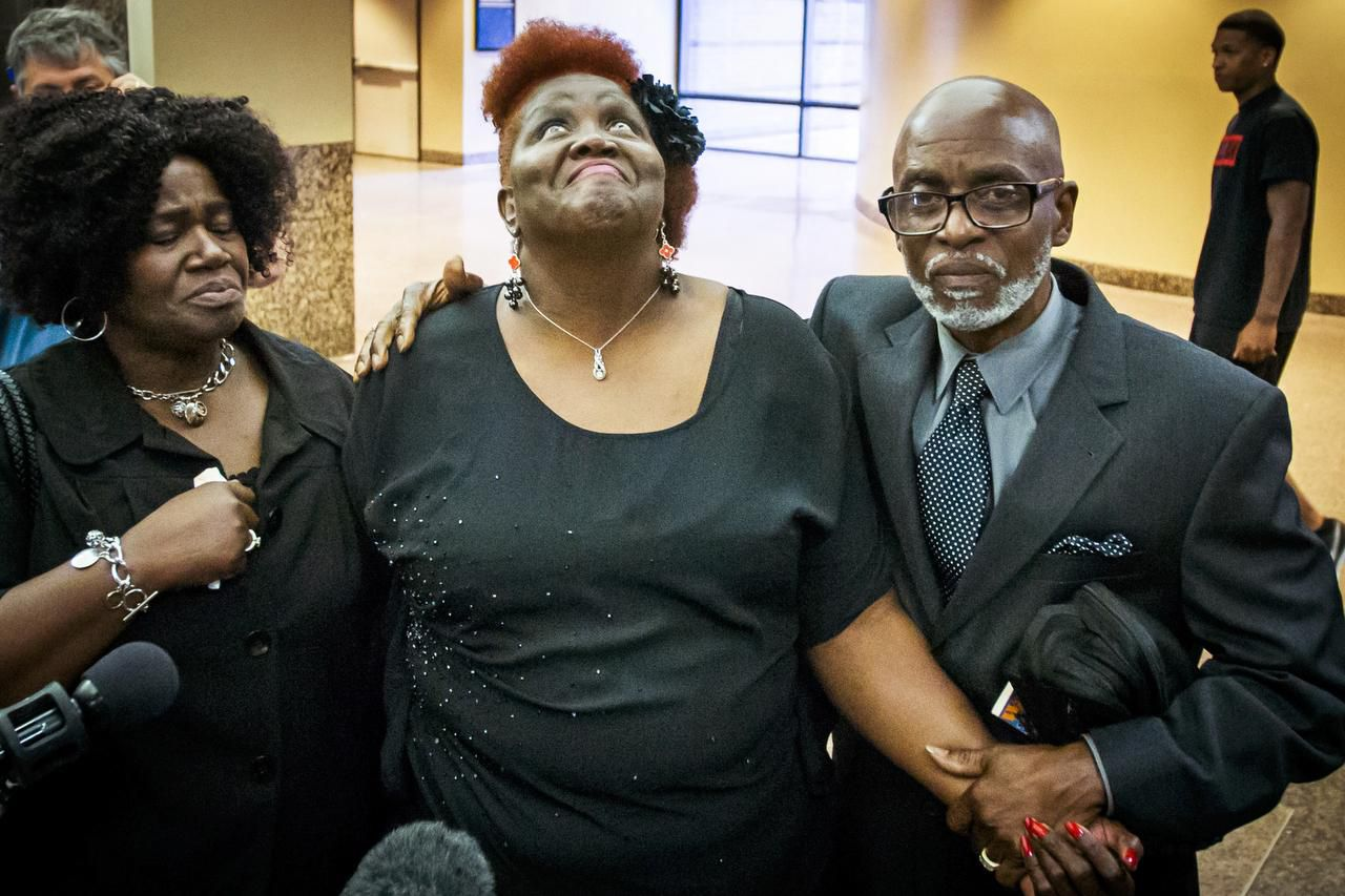 Vickie Cook (center), Deanna Cook's mother, leaves the courtroom after the jury returned a guilty verdict in the murder trial of Delvecchio Patrick. He was convicted of killing his ex-wife while she was on the phone with 911 in 2012.