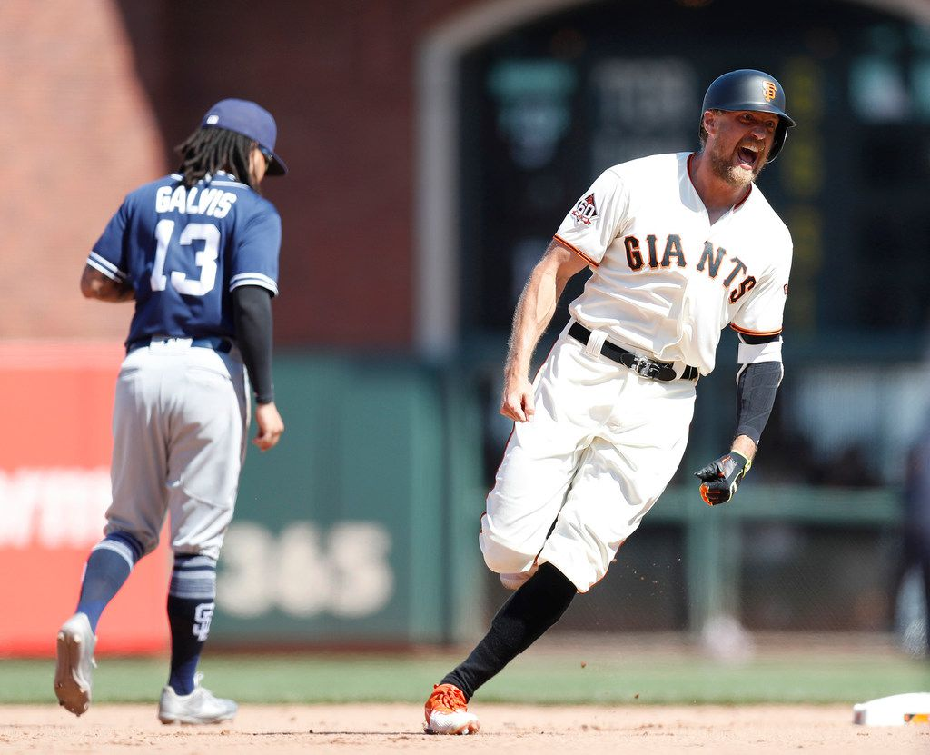 The San Francisco Giants' Hunter Pence celebrates his two-run double to beat the San Diego Padres, 3-2, in the 11th inning at AT&T Park in San Francisco on June 24, 2018. Pence signed a minor-league deal with the Texas Rangers ahead of the 2019 season. (Nhat V. Meyer/Bay Area News Group/TNS)