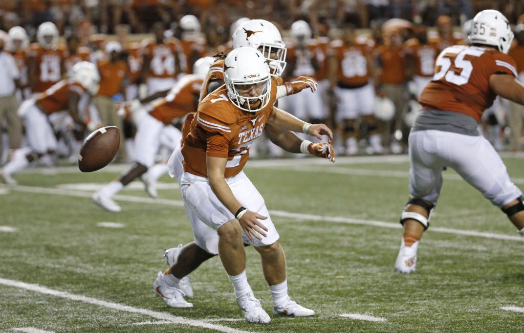 Texas quarterback Shane Buechele (7) chases a wayward snap in the fourth quarter during the Notre Dame Fighting Irish vs. the University of Texas Longhorns NCAA football game at Darrell K. Royal Memorial Stadium in Austin on Sunday, September 4, 2016. (Louis DeLuca/The Dallas Morning News)