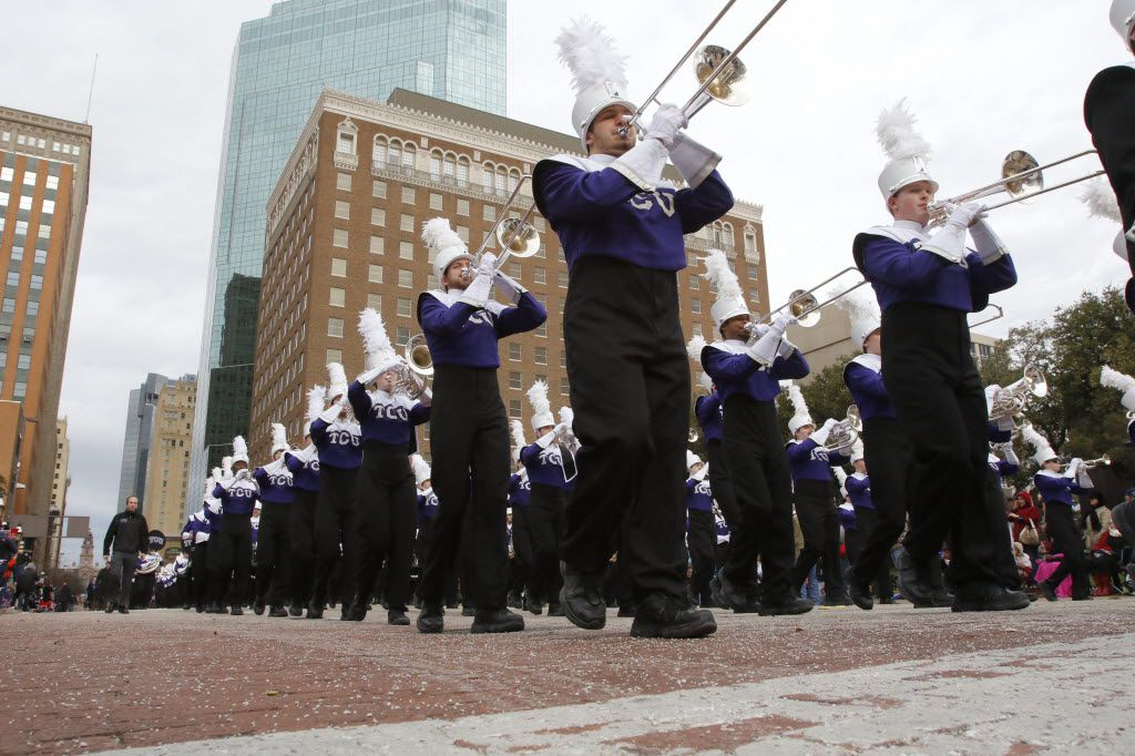"The TCU marching band performs in the Fort Worth Stock Show ""All Western Parade"" in downtown Fort Worth in 2016."