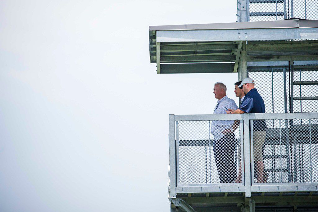Dallas Cowboys executive vice president Stephen Jones (left) watches from a tower during the team's minicamp at The Star on Wednesday, June 13, 2018, in Frisco. (Smiley N. Pool/The Dallas Morning News)
