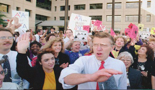 aption: Robert Crandall, at right center, chairman of American  Airlines, talks with American Airline employees at a rally Friday afternoon Nov. 19, 1993, at the airline's corporate headquarters  in Fort Worth, Texas, near Dallas/Fort Worth Airport. Employees  gathered to show support for the company and for Crandall.