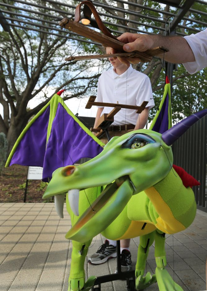 A dragon puppet makes an appearance at JadeWaters, the water park and lazy river at the Hilton Anatole Hotel in Dallas, photographed on Friday, May 26, 2017. (Louis DeLuca/The Dallas Morning News)