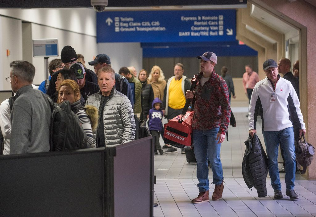 Travelers waited to go through a TSA security entrance in Terminal C while others arrived at DFW Airport on Dec. 18, 2017.