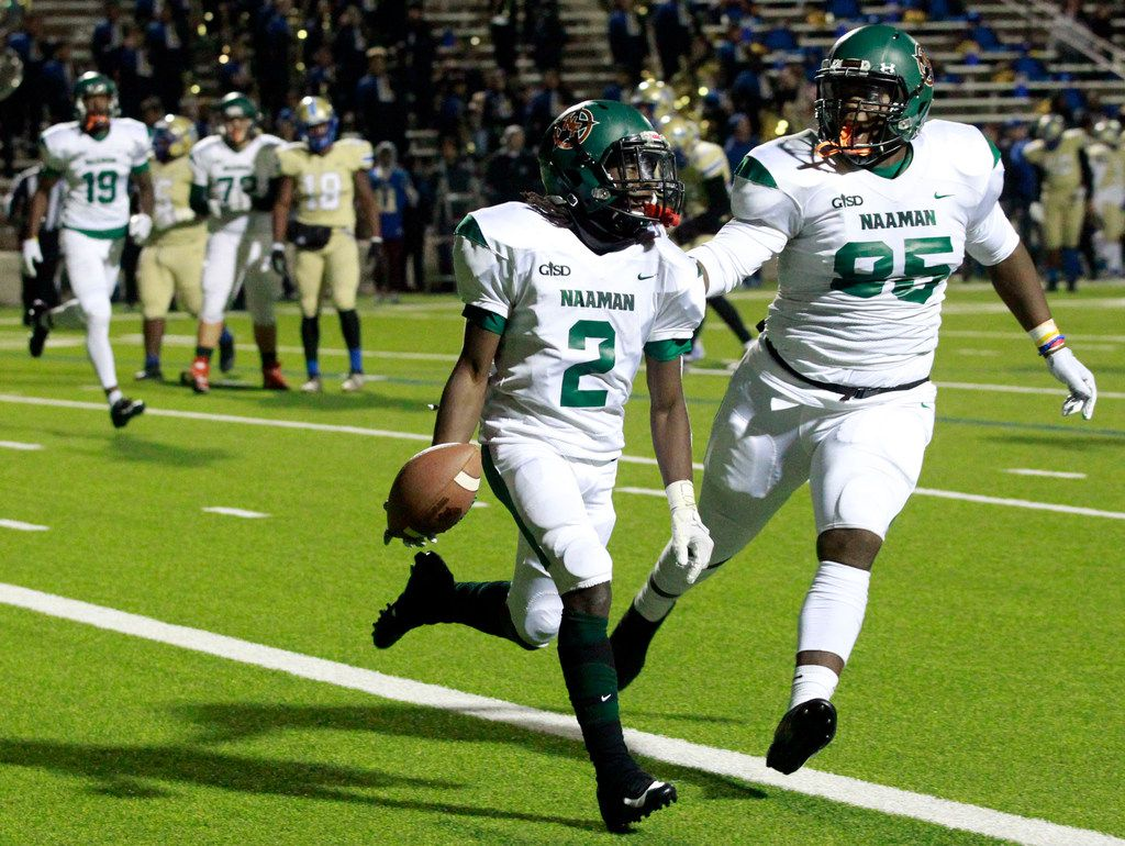 Garland Naaman Forest running back Kingsley Bennett (2) celebrates with teammate Jau'qwez Jones after taking his fumble recovery back for a touchdown during Friday's 42-27 win over Garland Lakeview that gave Naaman Forest a playoff berth. (John F. Rhodes / Special Contributor)