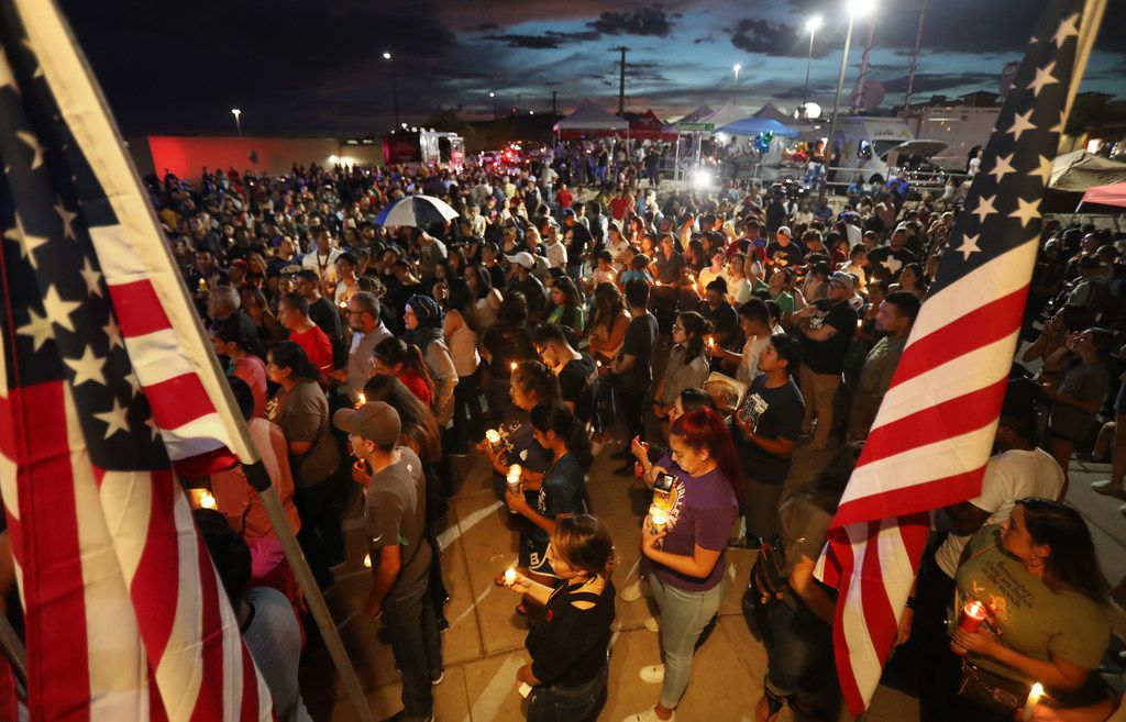People attend a candlelight vigil on Aug. 7 at a makeshift memorial honoring victims of a mass shooting which left at least 22 people dead, on Aug. 7, 2019 in El Paso. President Donald Trump visited the city earlier today. A 21-year-old white male suspect remains in custody in El Paso which sits along the U.S.-Mexico border.