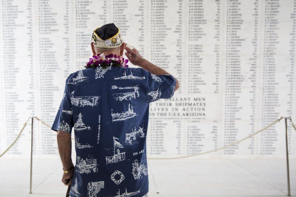 USS Arizona survivor Lou Conter salutes the Arizona Remembrance Wall in Hawaii.