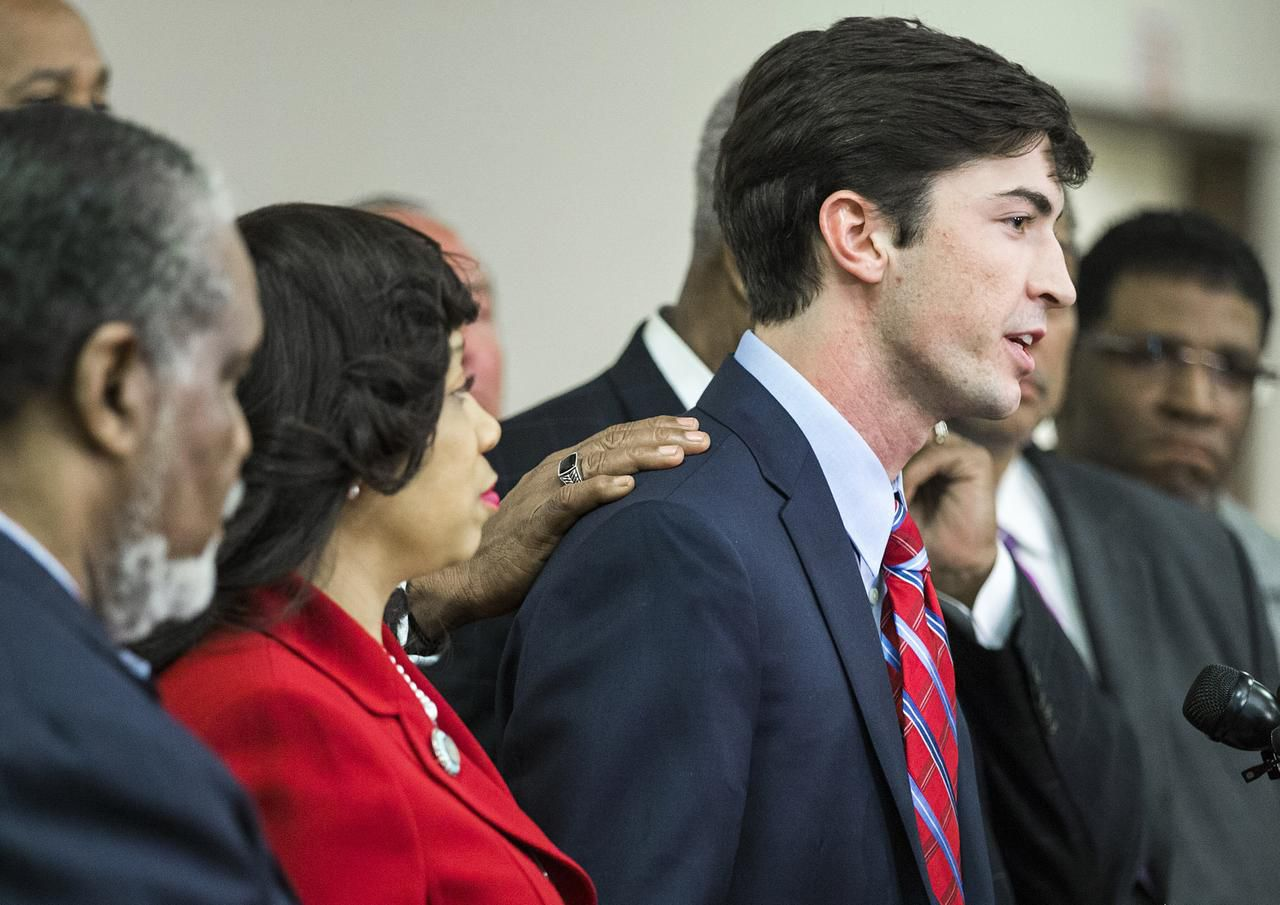 Levi Pettit was accompanied by several pastors, civil rights activists and politicians as he spoke Wednesday.