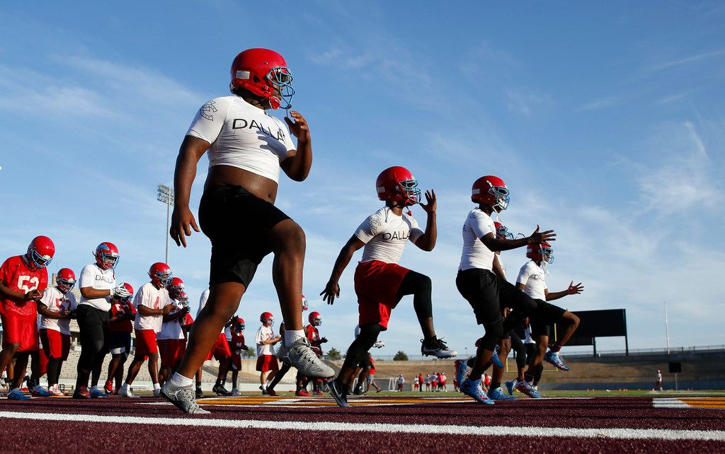 The Carter High School football team stretches during practice at Kincaide Stadium in Dallas, on Monday, August 6, 2018. (Vernon Bryant/The Dallas Morning News)
