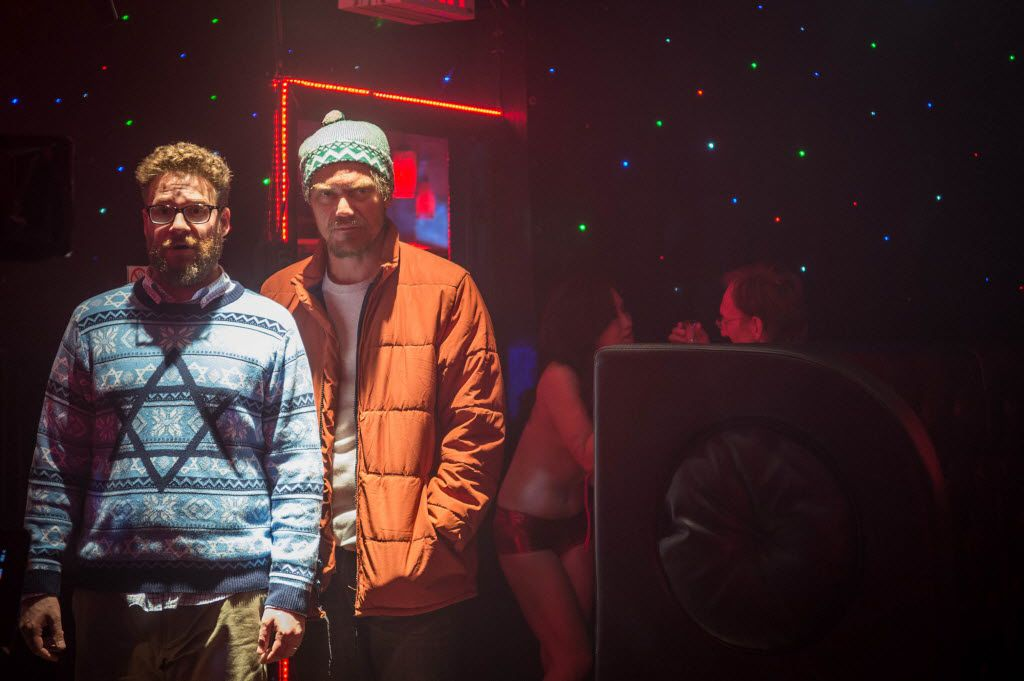 Seth Rogen, left, as Isaac, and Michael Shannon as Mr. Green