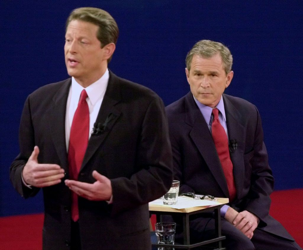 Vice President Al Gore speaks during an Oct. 17, 2000, presidential debate as GOP nominee George W. Bush, then Texas governor, watches at Washington University in St. Louis.
