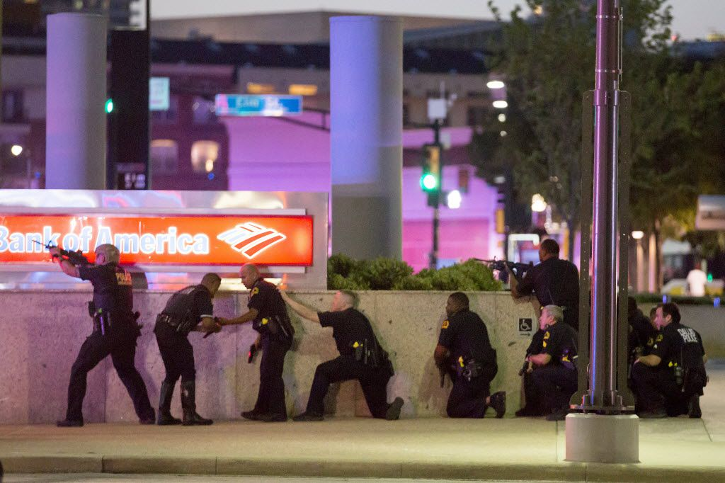 Dallas police took up position along a wall at the corner of Lamar and Main streets after shots were fired last July 7.