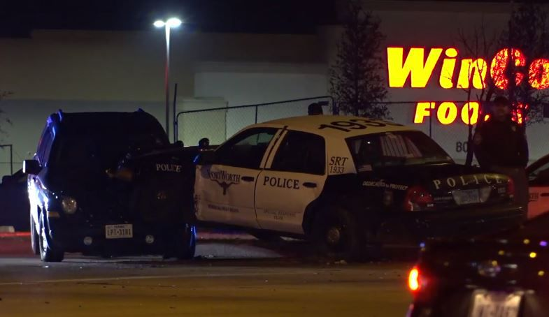A Fort Worth patrol car lies partially atop another vehicle after it was involved in a wreck while responding to a shooting outside a Home Depot. It is unclear if the officer was injured.