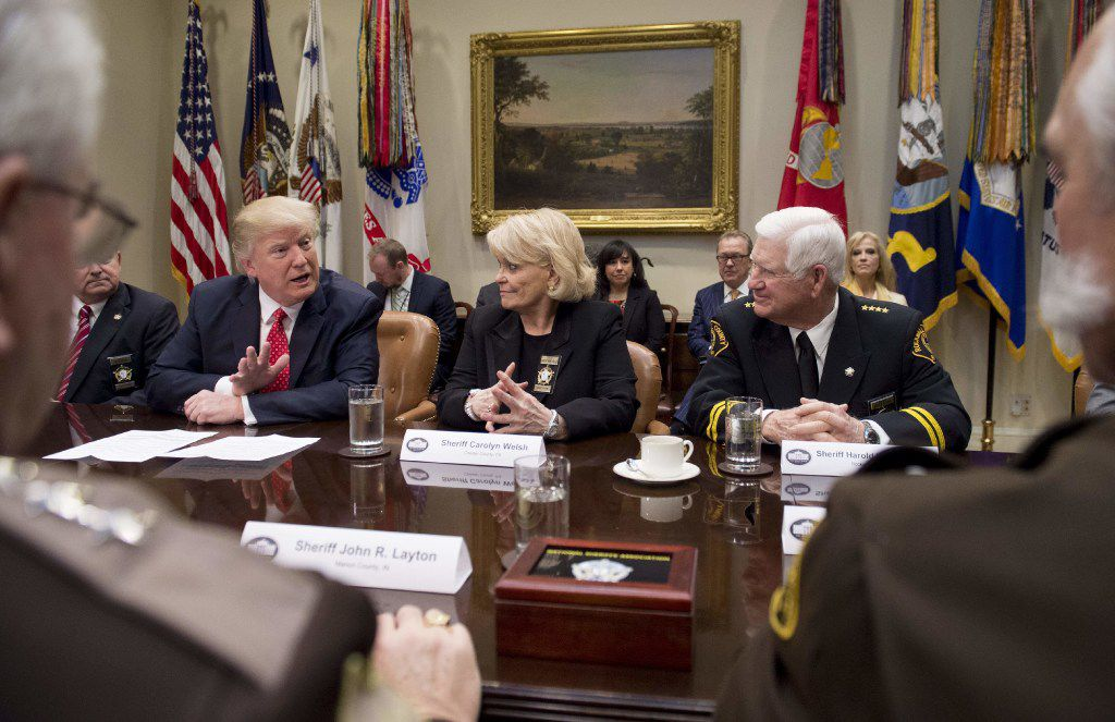 US President Donald Trump speaks alongside Sheriff Carolyn Bunny Welsh (C), of Chester County, Pennsylvania, and Sheriff Harold Eavenson (R), of Rockwall County, Texas, during a meeting with county sheriffs in the Roosevelt Room of the White House in Washington, DC, February 7, 2017. / AFP PHOTO / SAUL LOEBSAUL LOEB/AFP/Getty Images