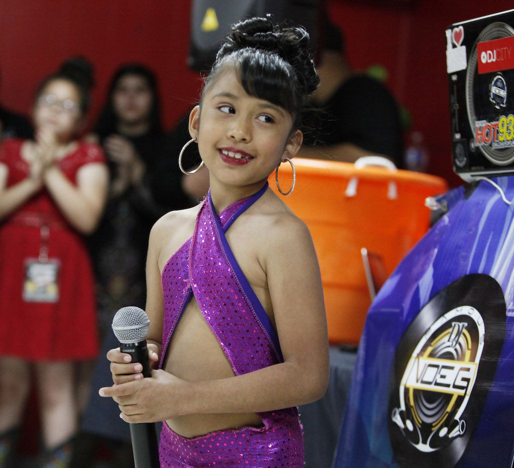 Azlie Garcia, 6, performs during Selena Day 2017 at Country Burger restaurant in Dallas.