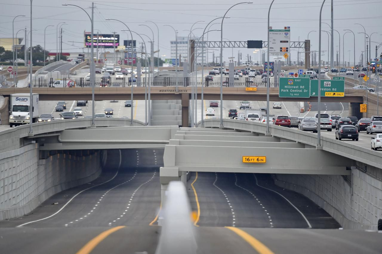 A new segment of the LBJ toll lanes,  seen with LBJ Freeway on either side, is set to open for business on Thursday. The prices rise and fall depending on traffic in the TEXpress lanes — the more congested the lanes, the higher the toll. The goal is to keep traffic at 50 mph or faster.
