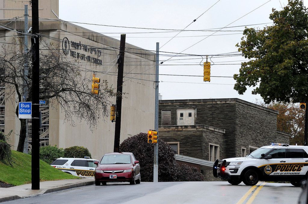 Police respond to an active shooter situation at the Tree of Life synagogue on Wildins Avenue in the Squirrel Hill neighborhood of Pittsburgh, Pa. (Pam Panchak/Post-Gazette via AP)