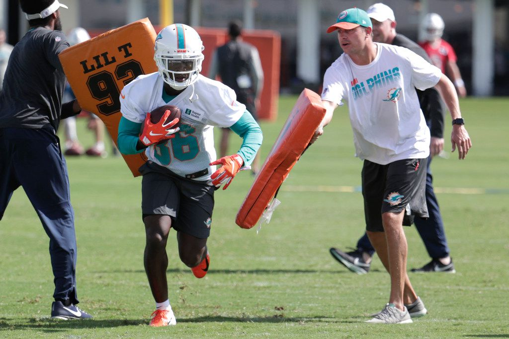 Miami Dolphins wide receiver Allen Hurns (86) runs drills during NFL football training camp, Friday, July 26, 2019, in Davie, Fla. Hurns, who suffered a leg injury with the Dallas Cowboys in January, signed a $3 million one-year contract Friday to play for his hometown team. (AP Photo/Lynne Sladky)