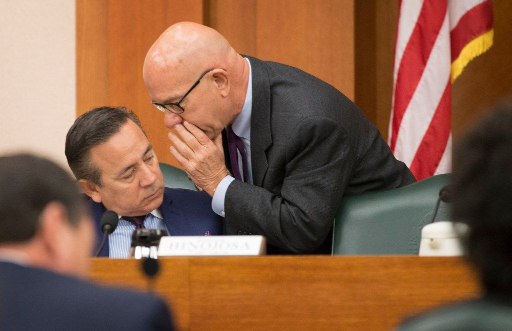 State Sen. Carlos Uresti, D-San Antonio, (left) and state Sen. John Whitmire, D-Houston, talked at a meeting of the Senate Finance Committee at the Capitol on Monday, January 30, 2017. (Jay Janner/Austin American-Statesman)