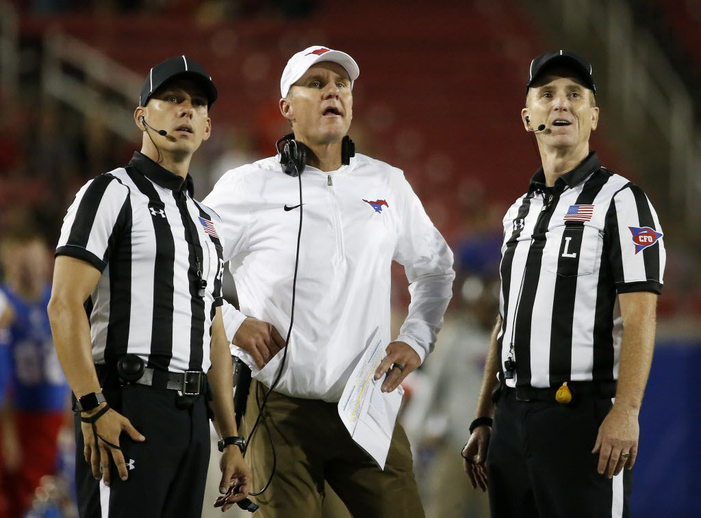 Southern Methodist Mustangs head coach Chad Morris (center) watches an instant replay on the score board during the fourth quarter against UCF at Gerald J. Ford Stadium on Saturday, Nov. 4, 2017, in Dallas. The Mustangs lost 31-24. (Jae S. Lee/The Dallas Morning News)