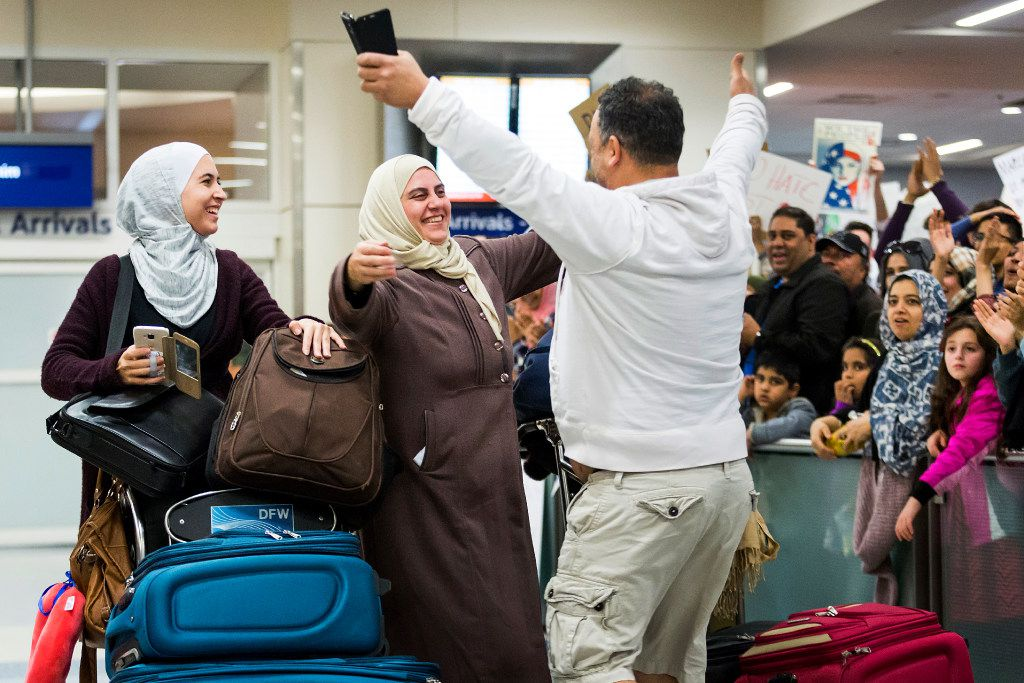 Motasim Abusaad of Irving runs to hug his sister Nancy Abusaad and his niece Zenna Jarrar as they arrive from Jordan at DFW International Airport on Sunday, Jan. 29, 2017. (Smiley N. Pool/The Dallas Morning News)