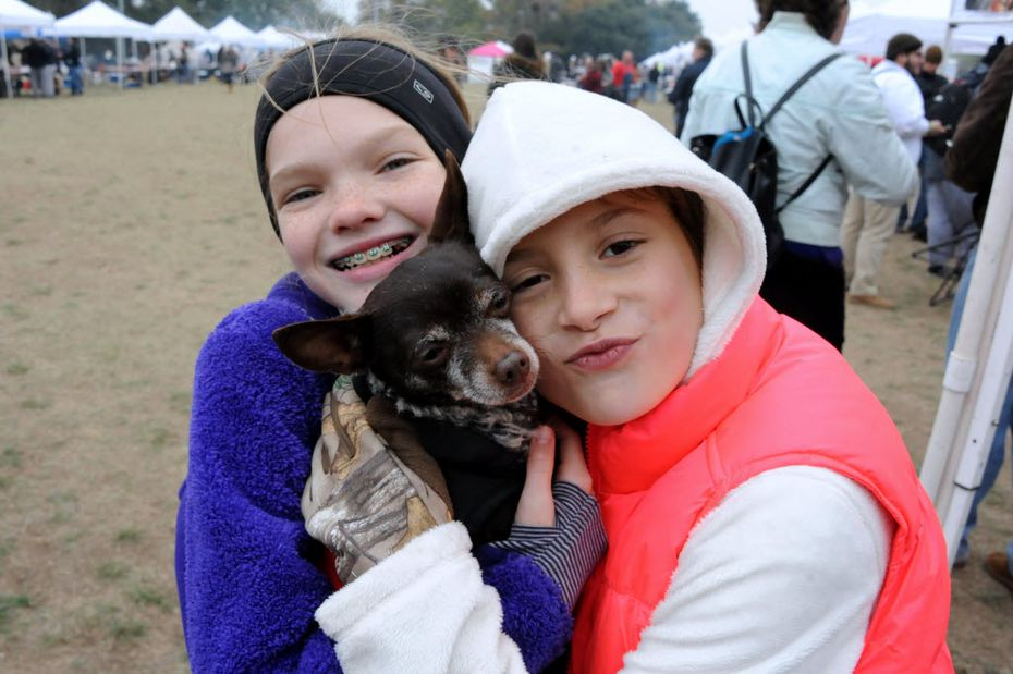 Friends Chloe Johnson and Vivienne Bull snuggled their puppy, Meaty, to keep him warm at a previous Blues, Bandits & Barbeque at Kidd Springs Park.