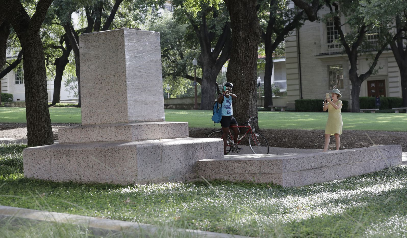 A pedestal wrapped in plastic that had held a statue of Confederate Gen. Robert E. Lee, which was removed from the University of Texas campus early Monday morning is photographed, Aug. 21, 2017, in Austin, Texas.
