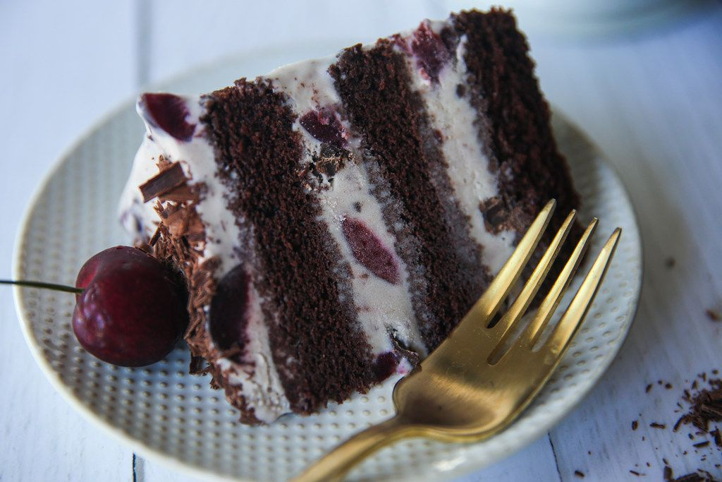 Black Forest Ice Cream Cake can be topped with cherries and shaved chocolate.