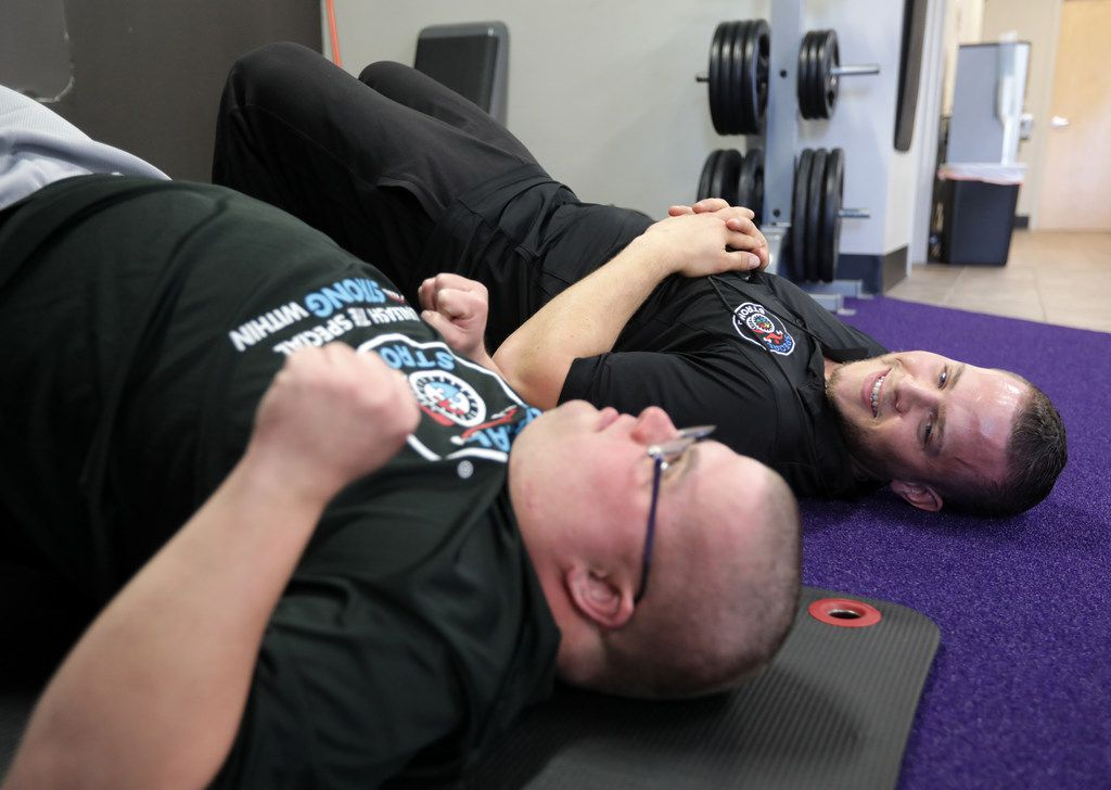 Josh Walters, 28, (left) and Daniel Stein with Special Strong exercise at Anytime Fitness in McKinney.