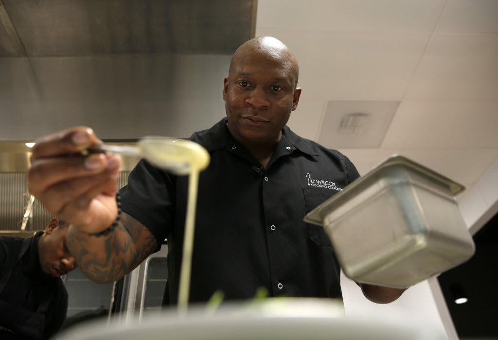 Chef Tre Wilcox drizzles dressing over salad during a cooking demonstration for media and guests at his new business, Tre Wilcox Cooking Concepts, in Plano on March 9, 2016.