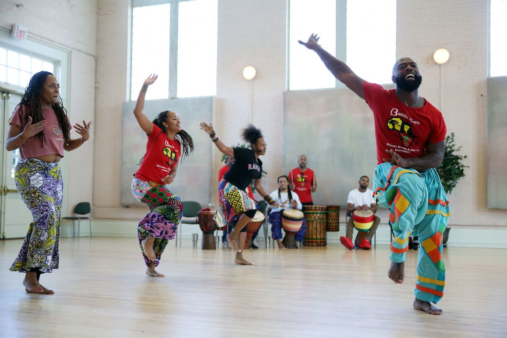 Bandan Koro African Drum and Dance Ensemble artistic lead Diata Brazelton (right) rehearses with the cast of Guinea Fare: Her Story, Her Ipseity at Sammons Center for the Arts.