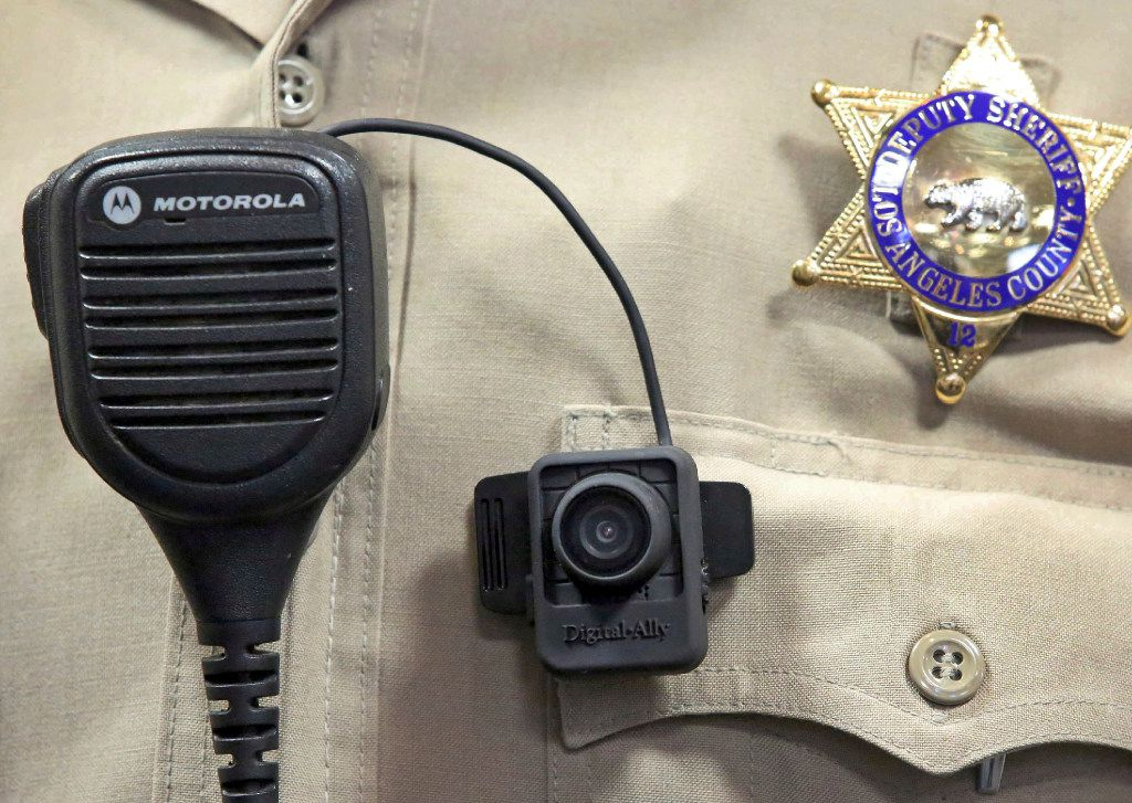In this Sept. 22, 2014 file photo, a body camera is displayed at a news conference at the Los Angeles County Sheriff's headquarters in Monterey Park, Calif.