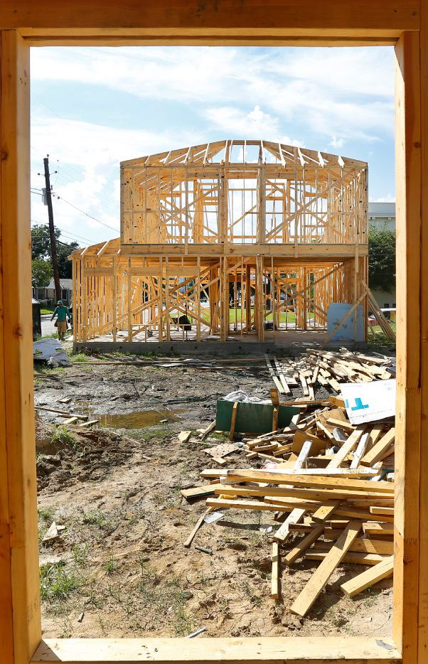 A pair of new homes are under construction along Malcolm X Blvd in South Dallas, Monday, July 10, 2017.