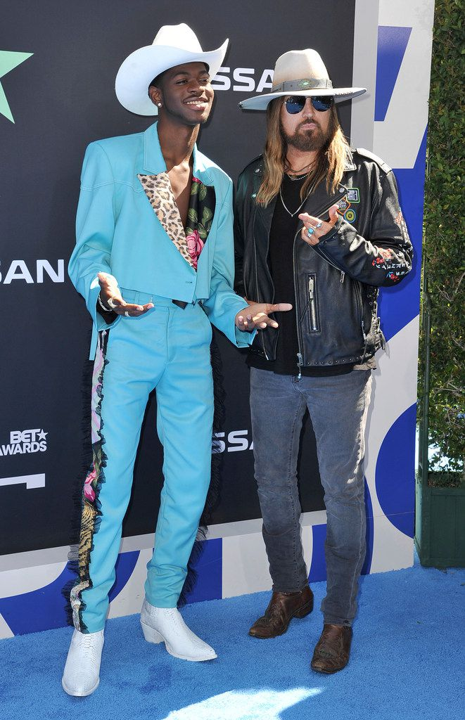 Lil Nas X, left, and Billy Ray Cyrus arrive at the BET Awards on Sunday, June 23, 2019, at the Microsoft Theater in Los Angeles.