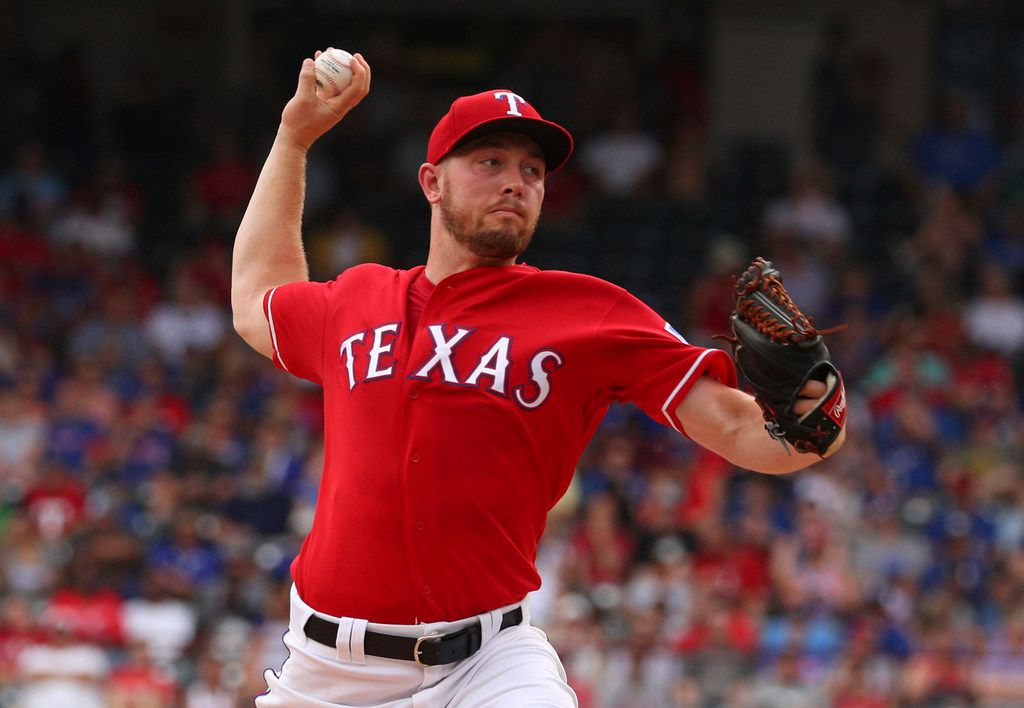 Texas Rangers starting pitcher Adrian Sampson delivers  in the second inning of a baseball game against the Chicago White Sox, Sunday, June 23, 2019. (AP Photo/ Richard W. Rodriguez)
