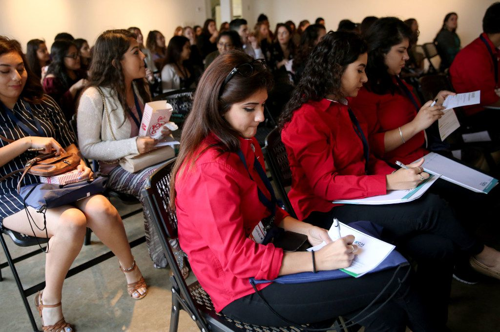 Genesis Vega, a junior at John Horn High School, writes down a question about becoming a teacher during the Extra Yard for Teachers Legacy Summit at SMU in Dallas on Wednesday. (Rose Baca/The Dallas Morning News)