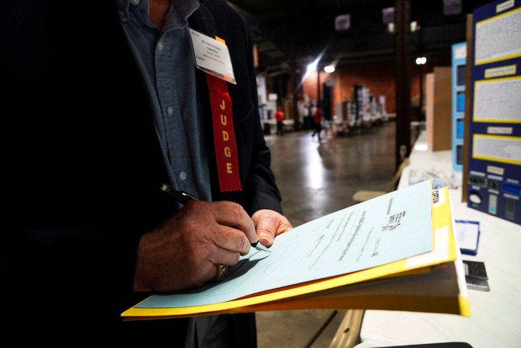 A judge scored an entry at the Dallas Regional Science and Engineering Fair last year in Fair Park.