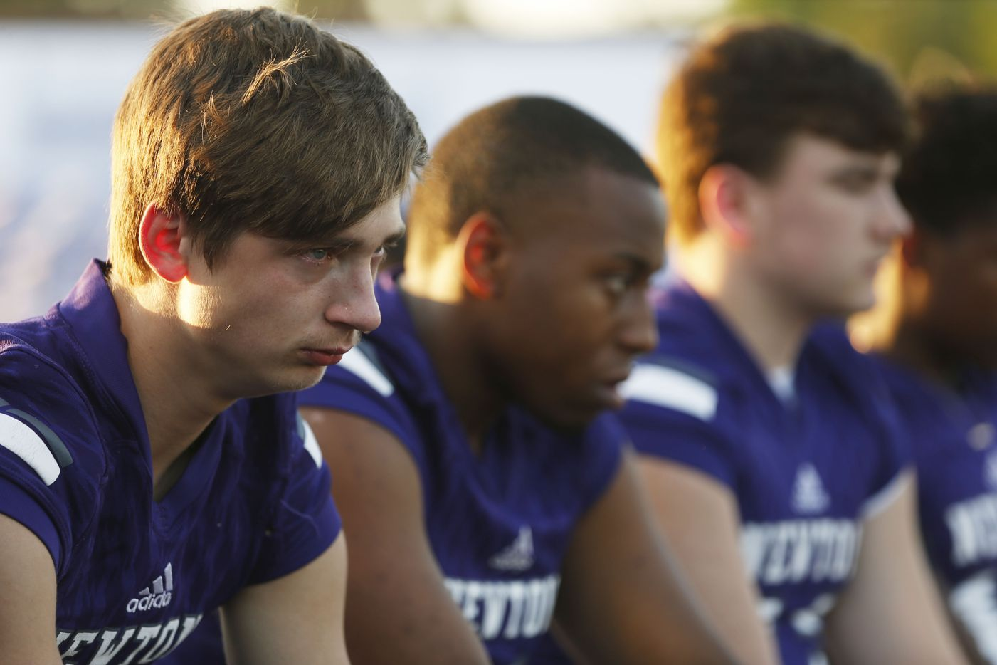 """Newton's Nate Williams cries as a song is sung during the memorial service for Newton High School head football coach William Theodore """"W.T."""" Johnston at Curtis Barbay Field at Newton High School in Newton, Texas on Wednesday, May 15, 2019. (Vernon Bryant/The Dallas Morning News)"""