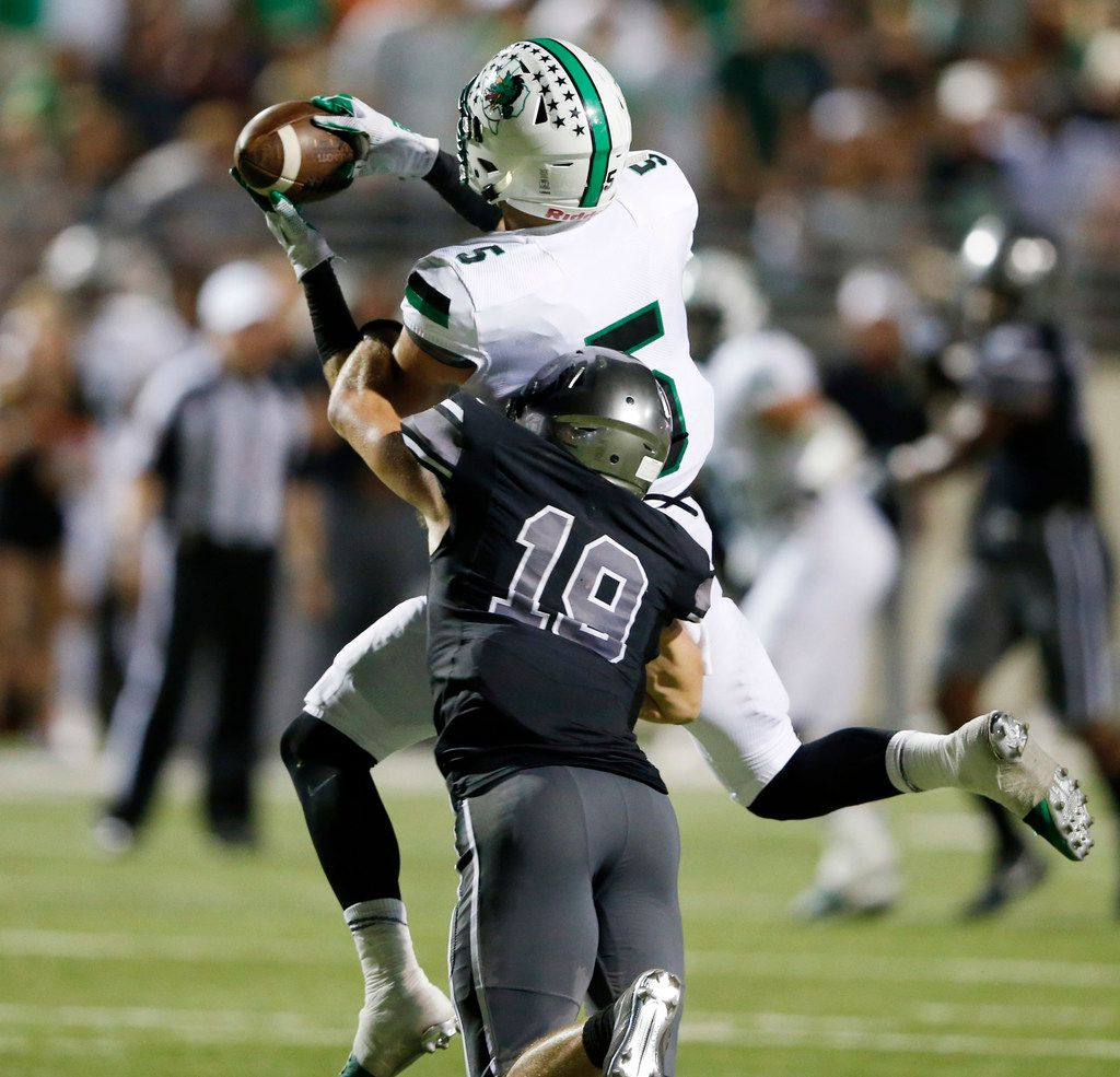 Southlake Carroll's Wills Meyer (5) catches a pass in front of Denton Guyer's Seth Meador (19) for a touchdown during the first half of play at C.H. Collins Complex in Denton, on Friday, October 4, 2019. (Vernon Bryant/The Dallas Morning News)