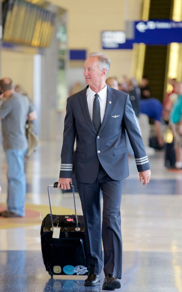 American Airlines First Officer Jon Schlegel, wearing one of the airline's new uniforms, heads to his flight to Frankfurt, Germany, at DFW Airport, Tuesday, September 20, 2016. (Brandon Wade/Special Contributor)