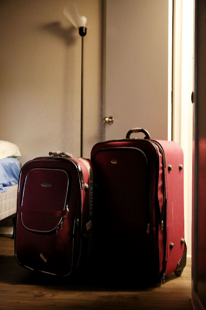 Suitcases belonging to the Jawish brothers' parents stand -- still packed -- in the corner of their apartment in Lake Highlands. (Andy Jacobsohn/Staff Photographer)