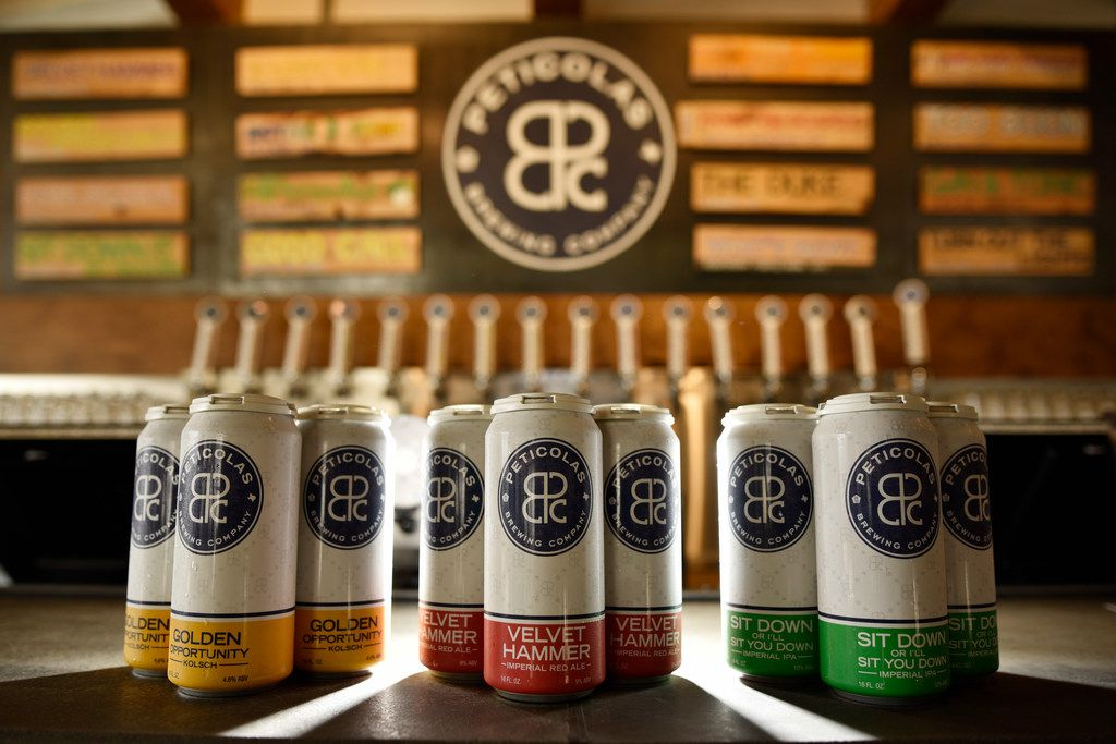 Golden Opportunity Kolsch, left, Velvet Hammer Imperial Red Ale and Sit Down Or I'll Sit You Down Imperial IPA six packs to go from Peticolas Brewing Company in Dallas, Aug. 24, 2019. Ben Torres/Special Contributor