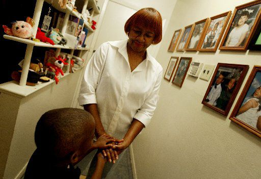 Dallas foster parent Margie Williams, shown with one of her foster children in 2006. (File Photo/The Dallas Morning News)