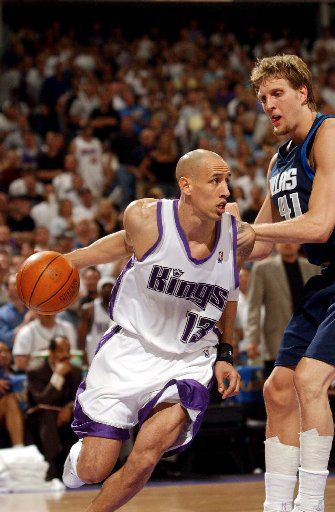 ORG XMIT: *S0408767563* Doug Christie drives past Dirk Nowitzki in the fourth quarter in game five of the first round of the NBA Western Conference playoffs between the Sacramento Kings and the Dallas Mavericks Thursday, April 29, 2004 at Arco Arena. Sacramento Bee photograph by Randy Pench  sacbee online