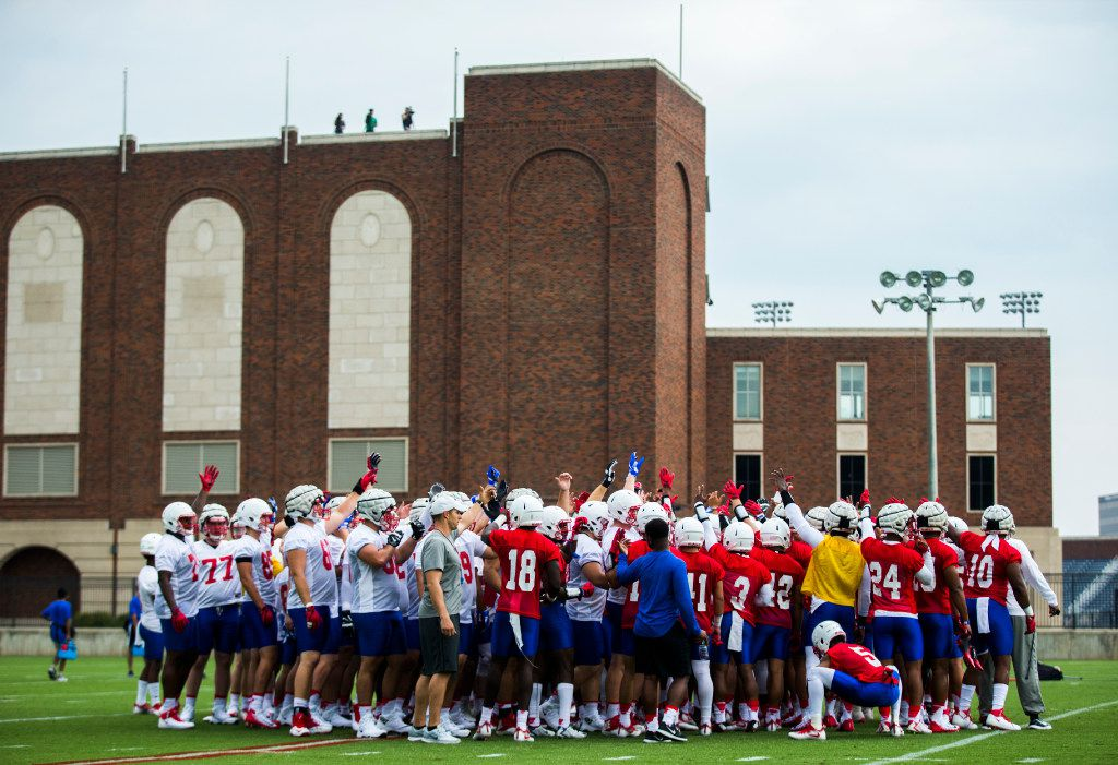 Football players huddle during SMU's first football practice of the season on Tuesday, August 1 , 2017 at the SMU practice fields in Dallas.  (Ashley Landis/The Dallas Morning News)