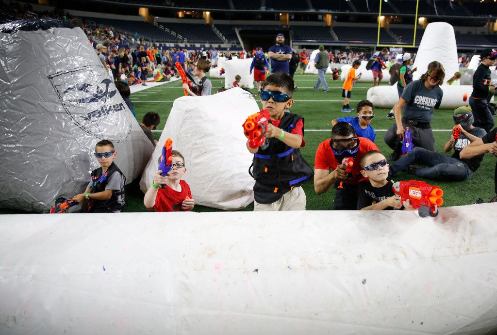 Kids and adults fire Nerf guns during Jared's Epic Nerf Battle 2 at AT&T Stadium in Arlington, Texas on Saturday, April 29, 2017. (Rose Baca/The Dallas Morning News)