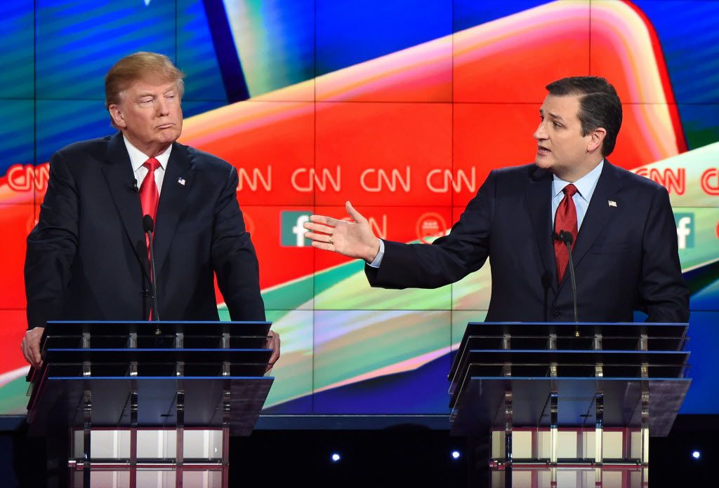 Sen. Ted Cruz speaks as Donald Trump looks on during the Republican Presidential Debate, hosted by CNN, at the Venetian Las Vegas on Dec. 15, 2015 in Las Vegas, Nev. (Agence France Presse Photo/Robyn Beck)