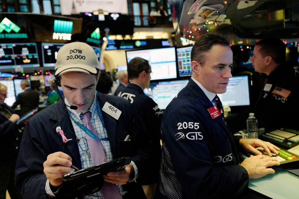 Traders work at the New York Stock Exchange on Dec. 22. (AP Photo/Mark Lennihan)