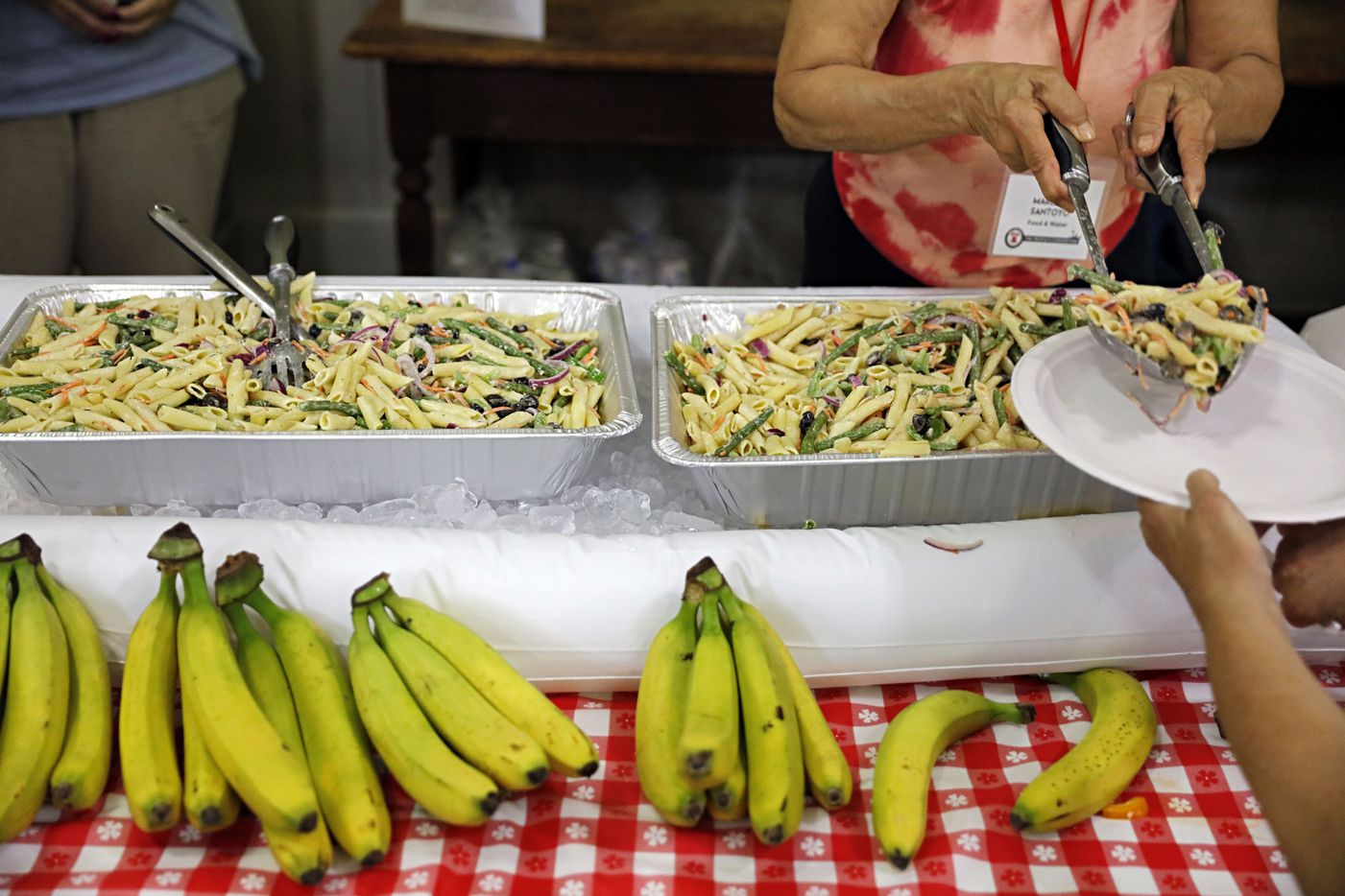 Pasta salad and bananas were offered to People's Convention attendees Saturday.