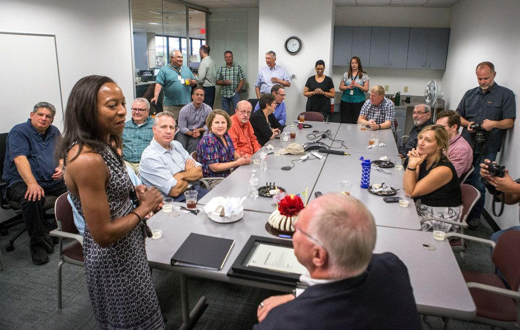 Kim Johnson, news editor, talks to Michael Graczyk, a journalist for The Associated Press, during a retirement celebration at the AP Dallas News Bureau on July 31. Over his career, Graczyk has witnessed and documented hundreds of executions in Texas.